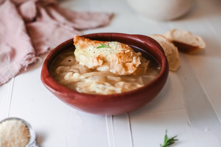 Onion soup in a bowl with bread on top