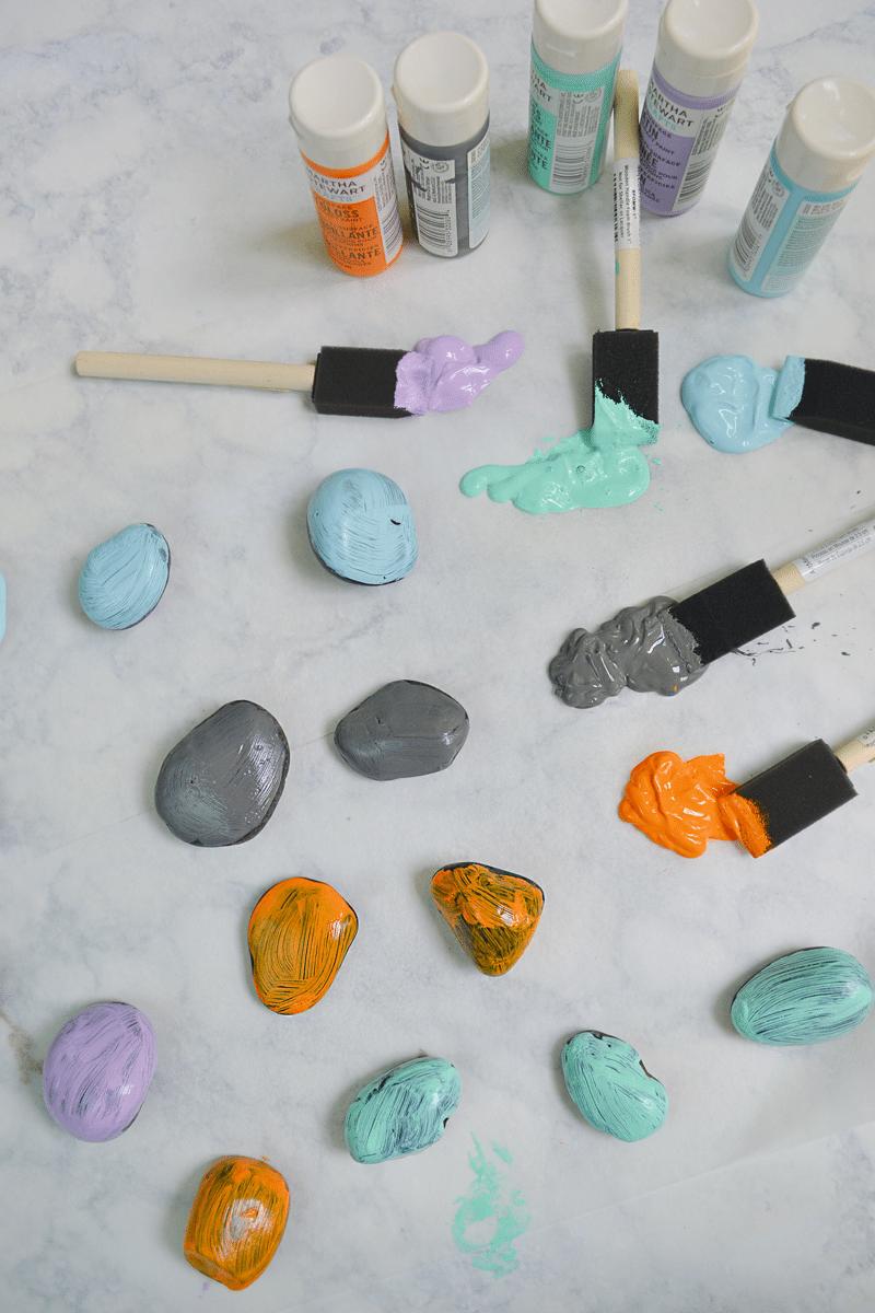 painting rocks for the garden rock caterpillar