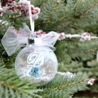 This DIY snow globe ornament is a simple craft/diy that will make a huge difference in your Christmas decorating. It is a fun ornament for a tree or just around the house!