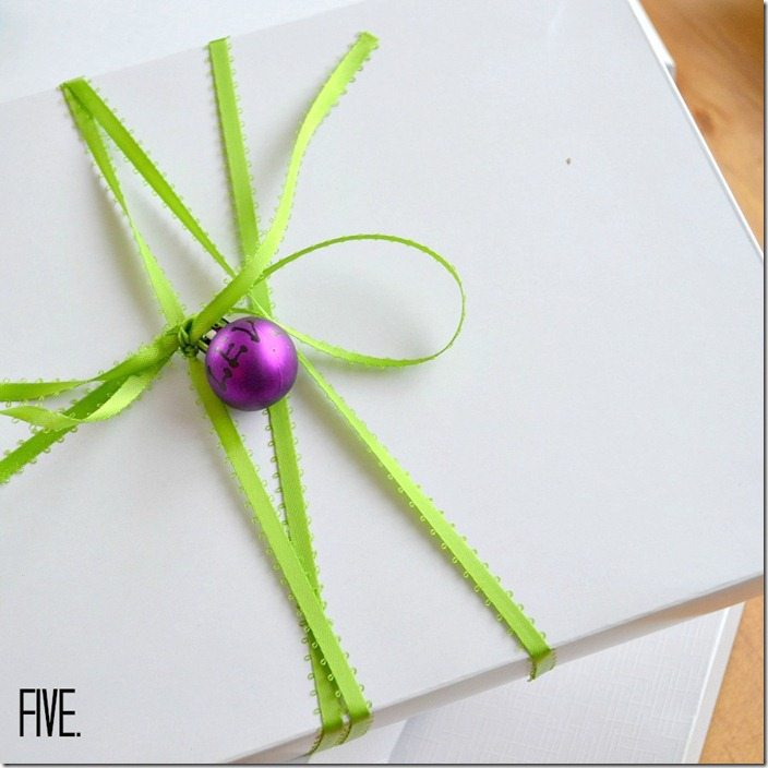 use a mini ornament as a gift tag: NellieBellie