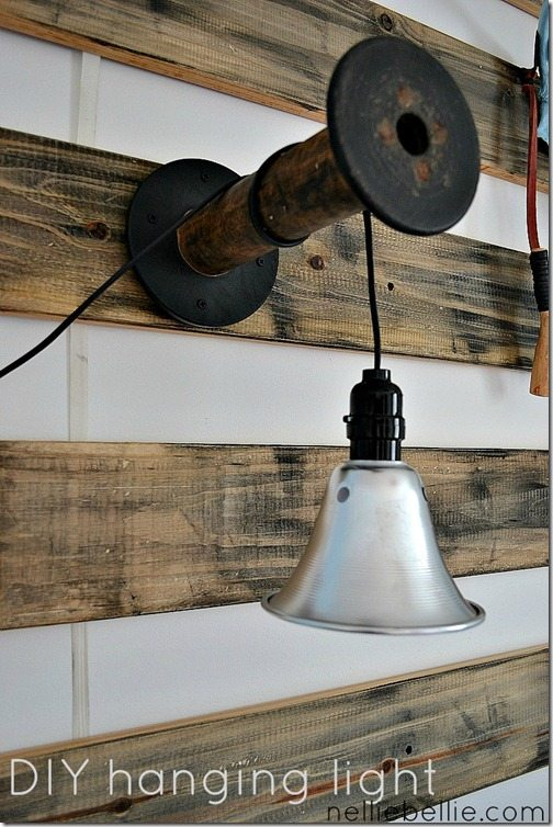 DIY light from shop light and wooden spool (or any kind of bracket). how cool is this!! from https://www.nelliebellie.com