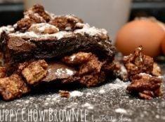 These delicious puppy chow brownies are a great mixture of a traditional brownie and puppy chow. They combine two great desserts into one!