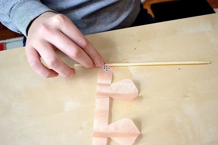attach tissue to pencil