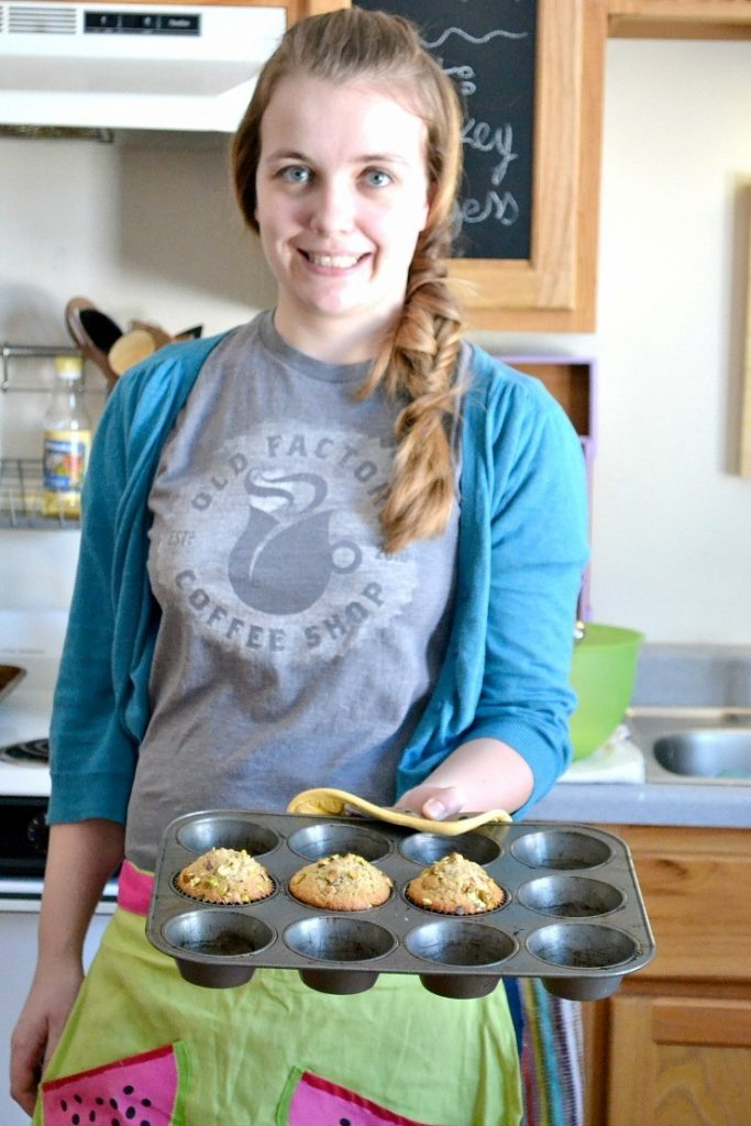 The Bellie looking adorable with pistachio muffins in her apron. nelliebellie.com