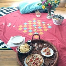 indoor picnic pizza party picnic blanket game board from nelliebellie.com