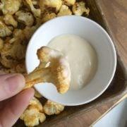 Roasted buffalo cauliflower recipe from nelliebellie.com healthy snack ideas