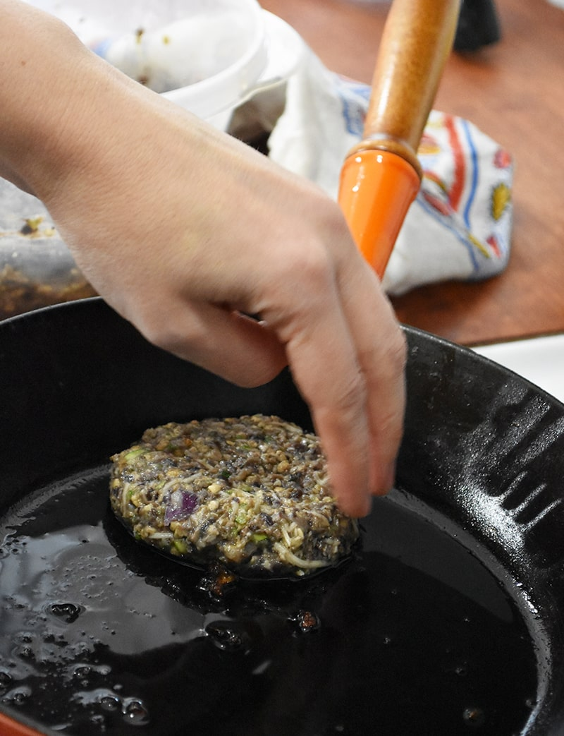 veggie burgers being fried up in the pan. Easy to make and they are fast!