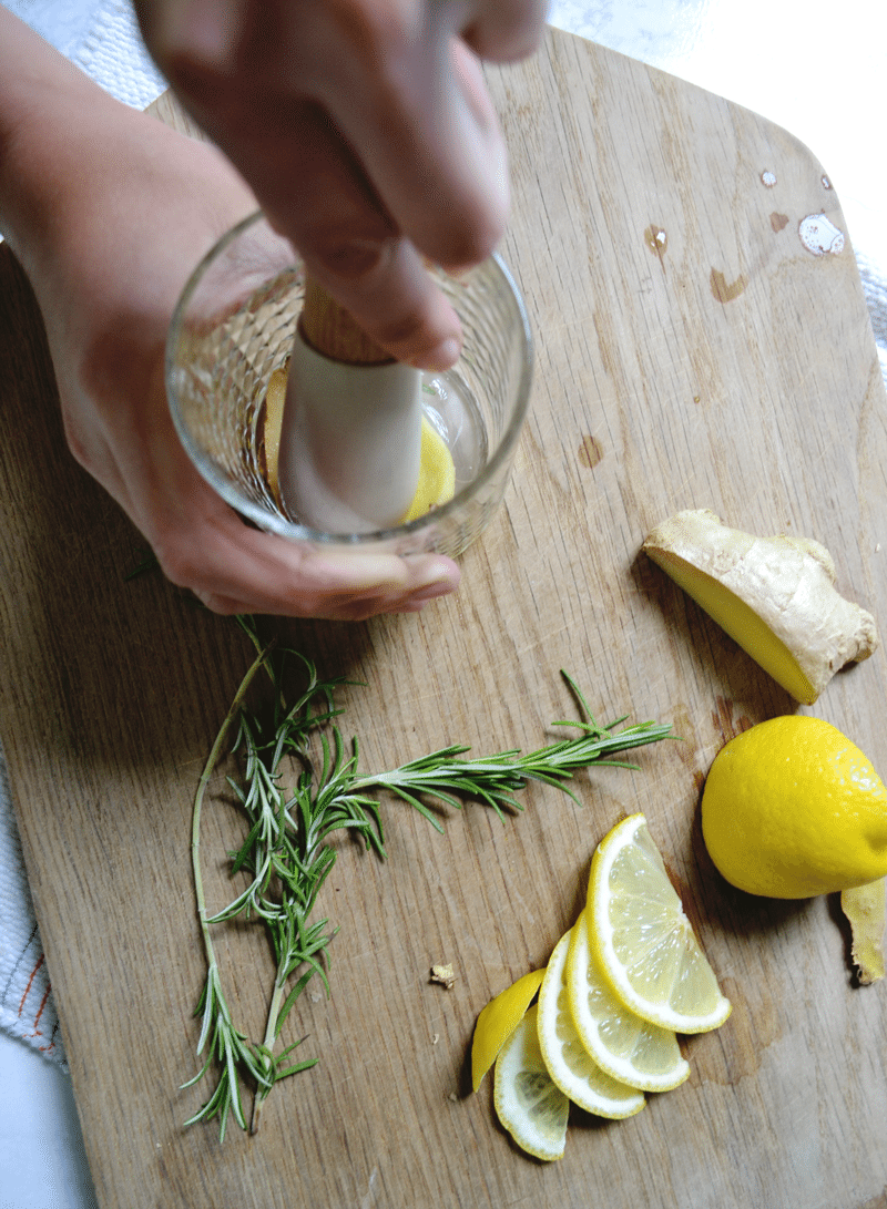 ginger-rosemary-lemon-gin-cocktail-muddling