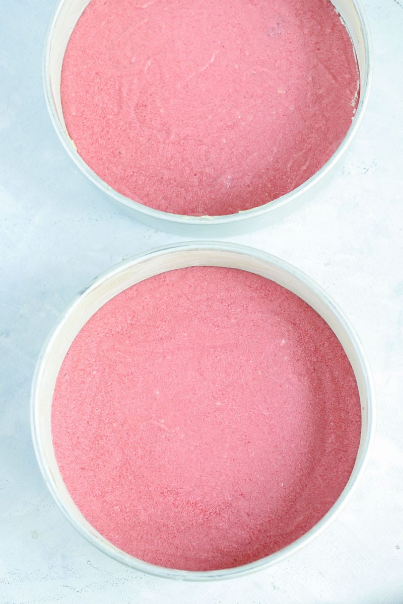 strawberry cake batter in pans
