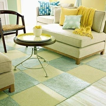 Use carpet squares to create a customize an area rug. Great cheap flooring idea.