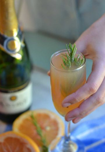 Rosemary Grapefruit Mimosa Recipe is easy to make a delicious, interesting change to the traditional mimosa recipe.