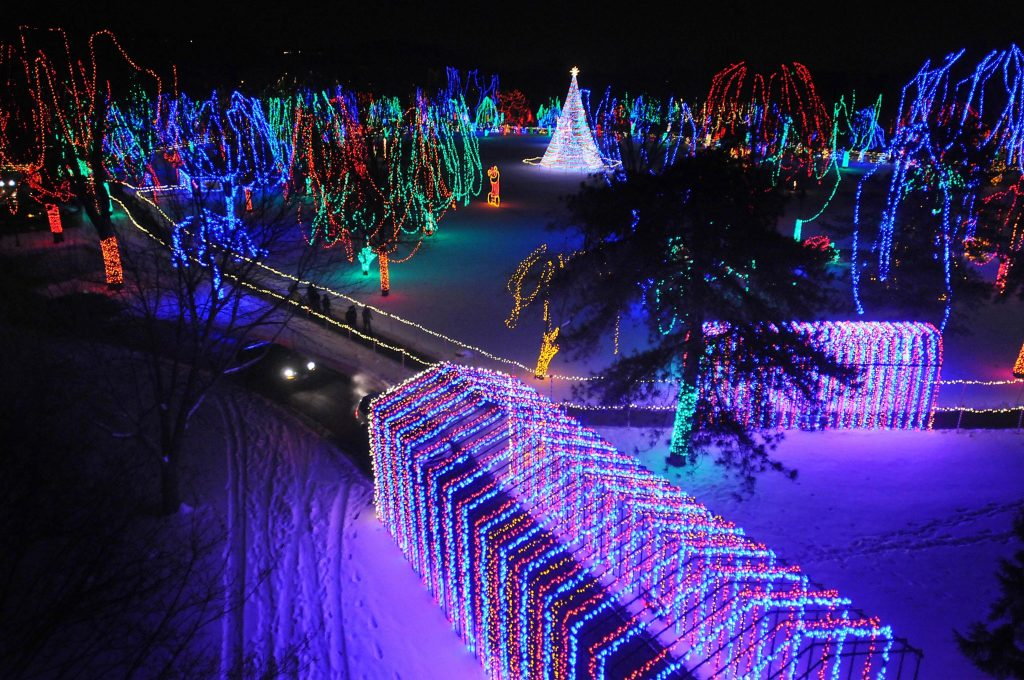 Pat Christman Cars travel through the lighted tunnel at the Kiwanis Holiday Lights as the rest of Sibley Park shines behind it last week. The park is lit up for 33 nights this Christmas season.