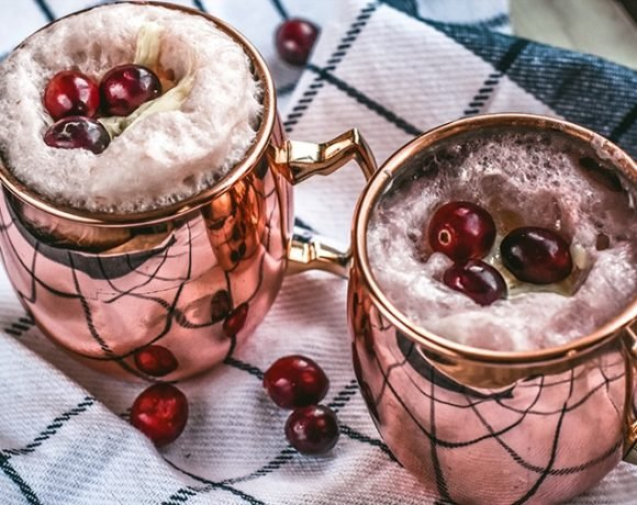 Cranberry moscow mule recipe. Easy to make and so pretty to serve! Add a scoop of vanilla ice cream and turn this into a festive dessert!