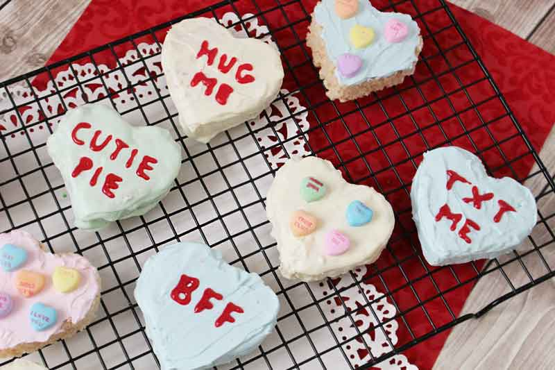 Make these cute Rice Krispie treat conversation hearts for a great Valentine's Day activity with kids!