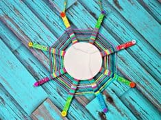 this God's Eye craft is an update on the classic craft featuring popsicle sticks and string. We added a mirror and hung them in multiples for fun decor!