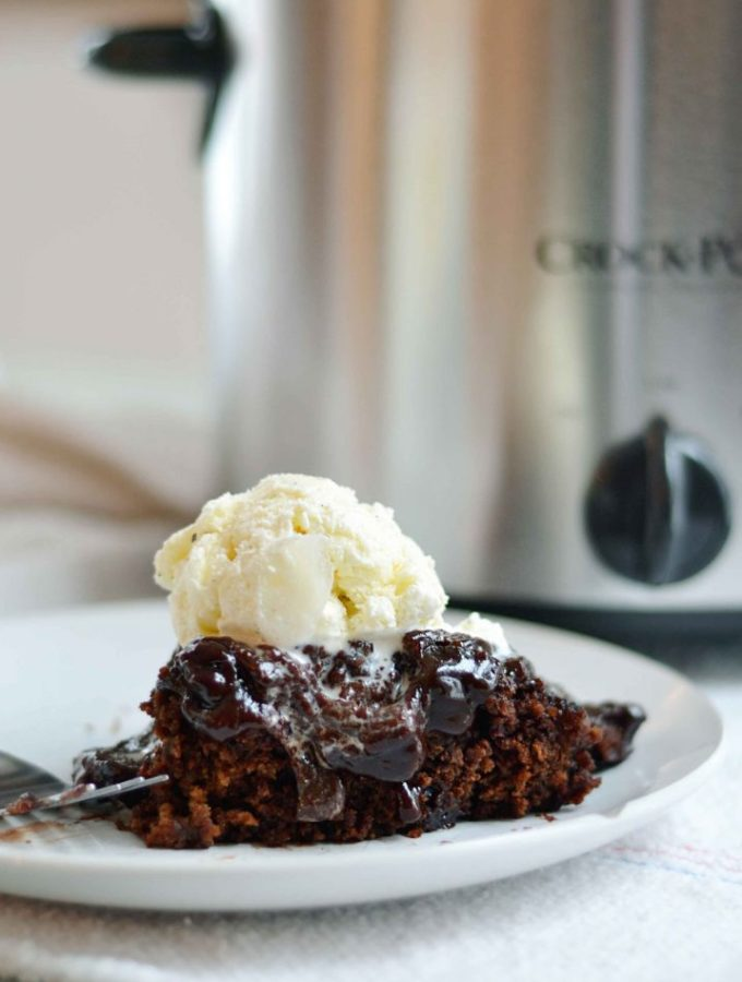Slow cooker chocolate stout cake with frosting. This cake is crazy easy to make, features Stout to add depth of flavor without crazy sugar amounts, AND it self frosts. REally! The frosting gets all wonderful while the cake is being made.