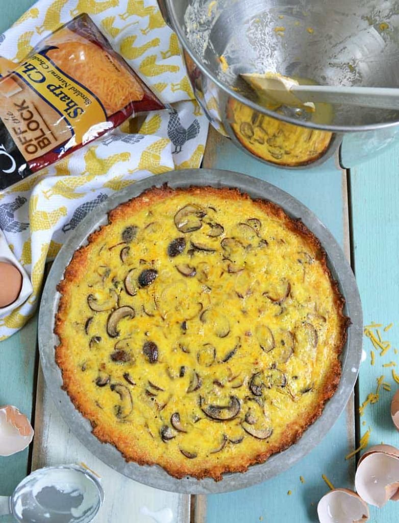 This easy quiche recipe features a cauliflower crust and some favorite farmer's market ingredients, mushrooms and leeks. Recipe from NellieBellie