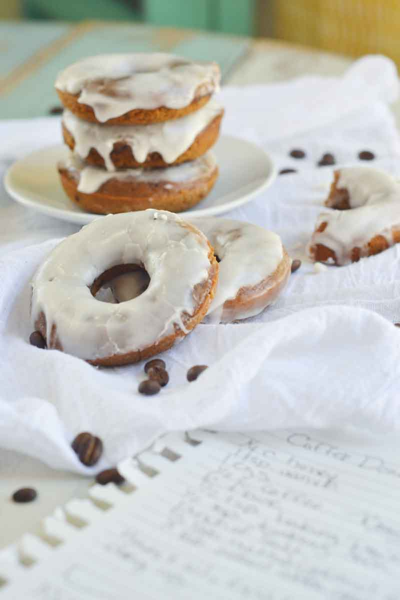 These baked coffee cake donuts are easy to make and jammed with coffee flavor and topped with a bold whiskey icing. The perfect start to your weekday breakfast!