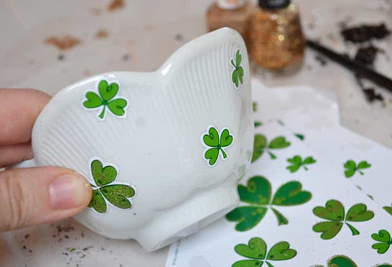 easy Saint Patrick's Day craft for kids. Use stickers and nail polish to make adorable planters to plant Shamrock plants in. A great neighbors gift!