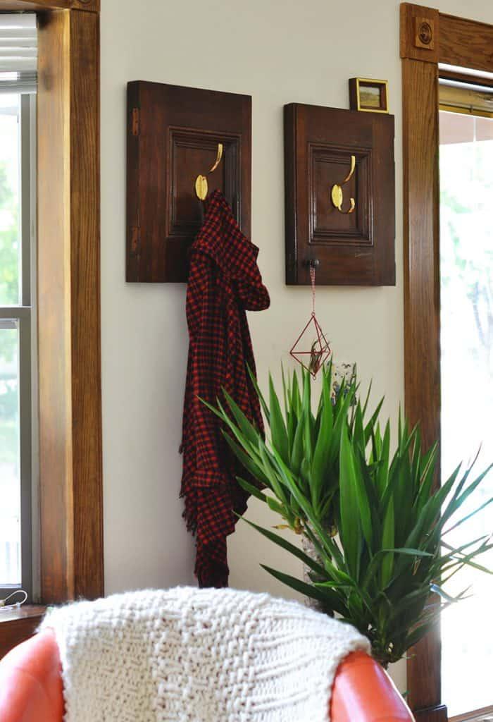 The repurposed cabinet doors into coat racks! Super charming and simple DIY