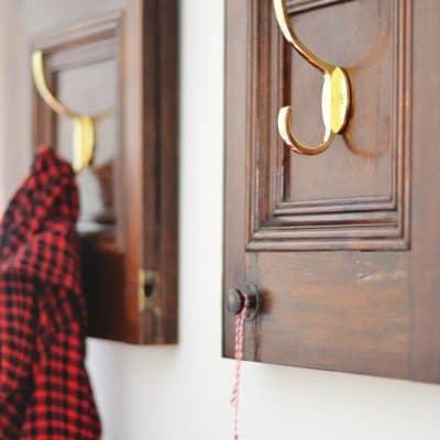 repurposed cabinet door into a coat rack