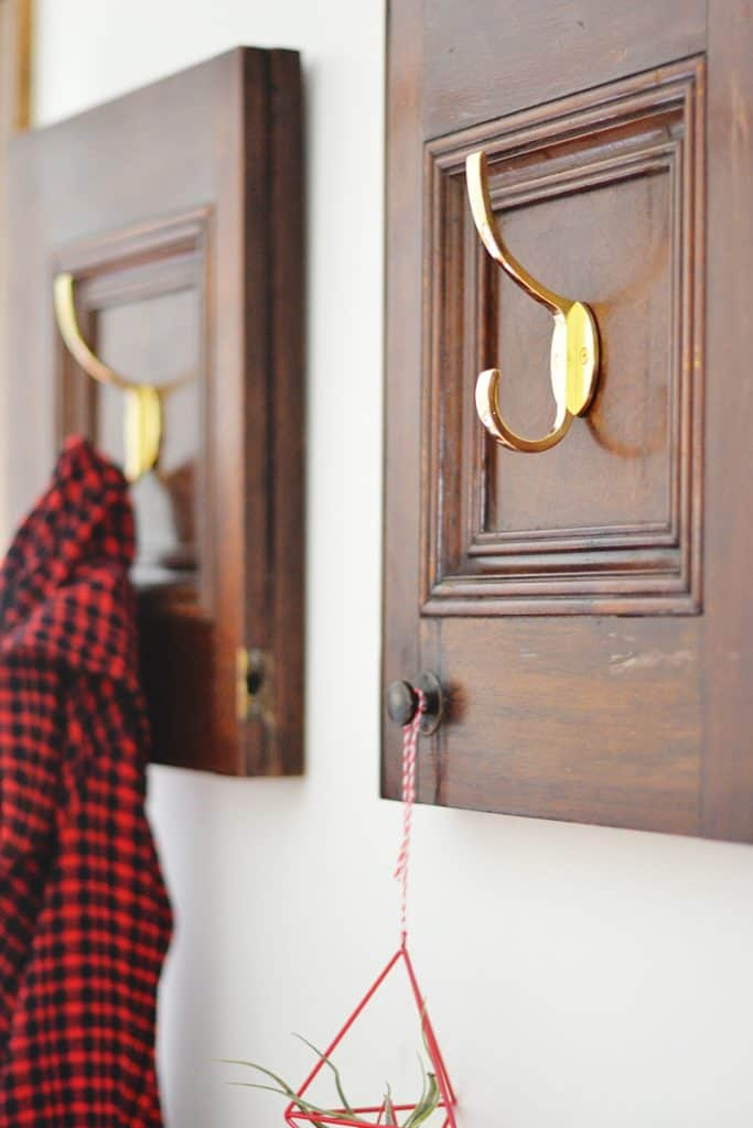 Repurposed cabinet doors into a charming coat rack in 3 easy steps! A DIY anyone can do!