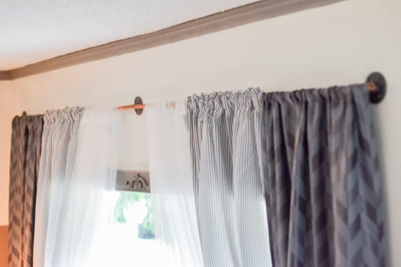living room makeover - after photo, copper pipe curtain rod