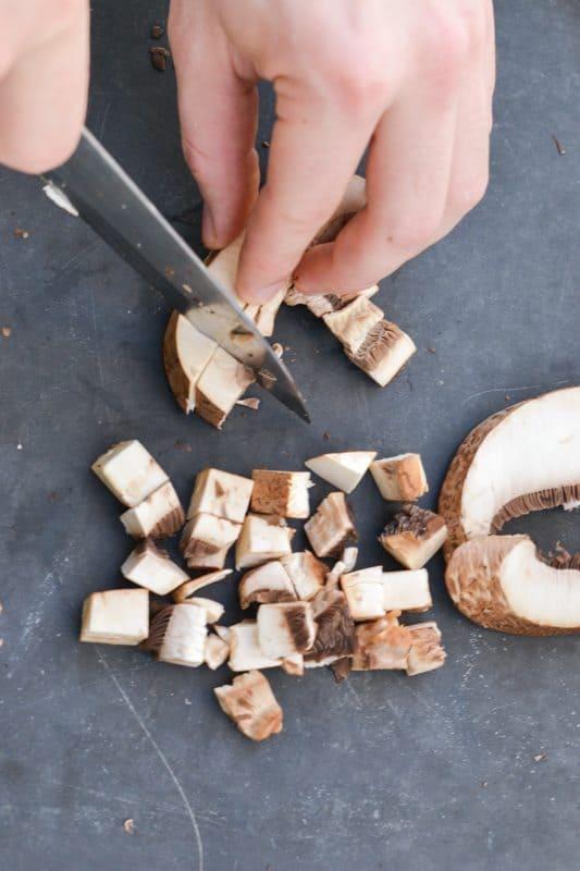 slicing mushrooms for homemade mushroom soup