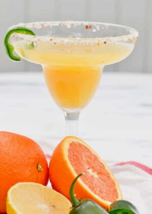easy margarita recipe with triple sec and tequila. Uses fresh juice from oranges to create the BEST sweet and spicy margarita!
