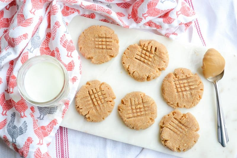 easy 3-ingredient peanut butter cookies. This recipe is gluten-free and dairy-free and great for kids to make by themselves (with oven supervision, of course)