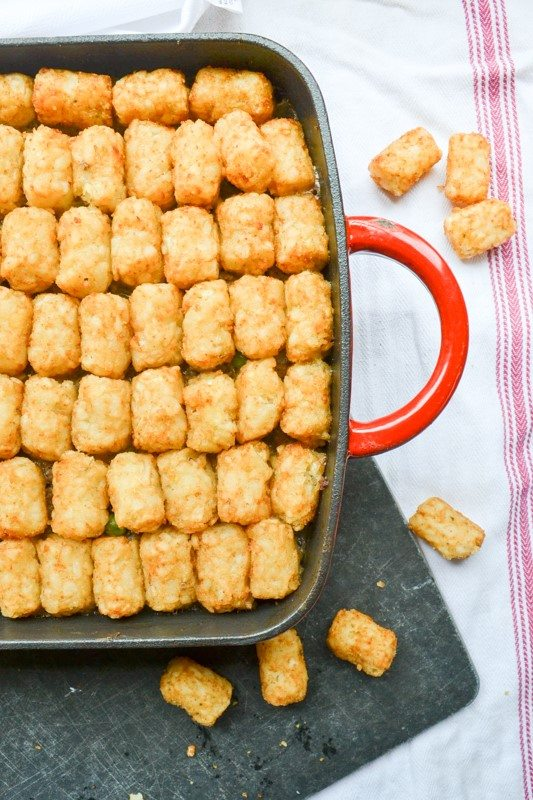 """Also called """"tater tot casserole"""", tater tot hotdish is a traditional Minnesotan dish complete with a variety of veggies and tater tots on top."""