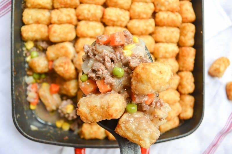 "Also called ""tater tot casserole"", Tater Tot hotDish is a traditional Minnesotan dish complete with a variety of veggies and tater tots on top."