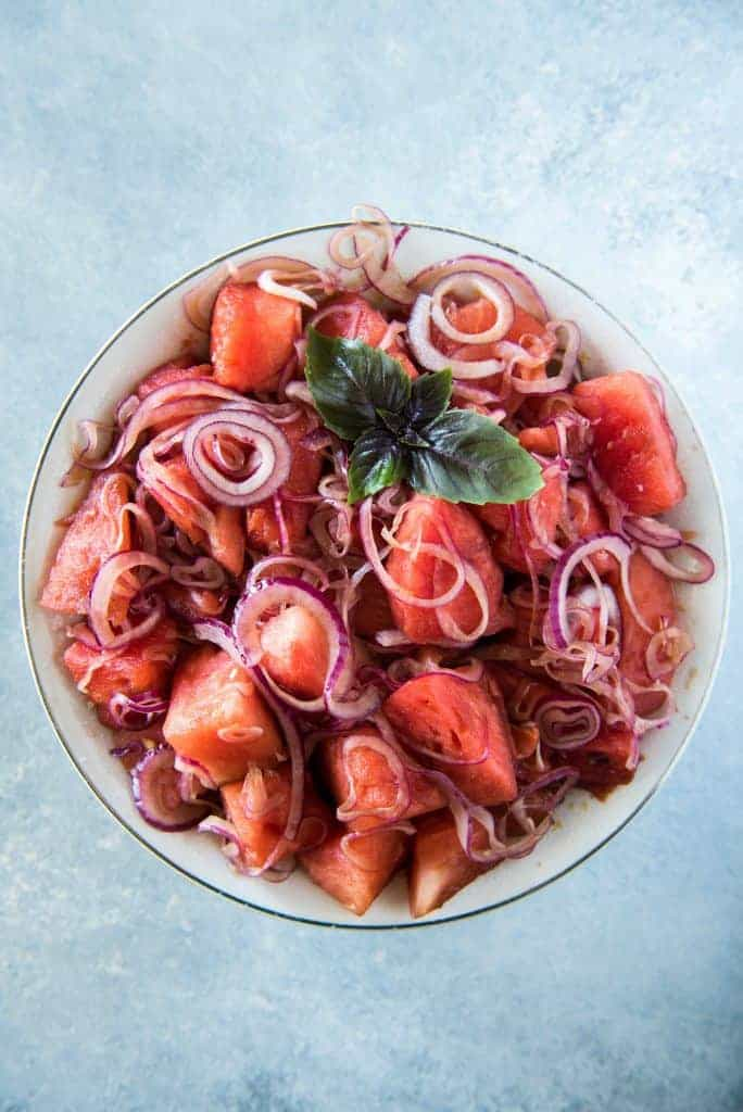watermelon salad with red onions in it