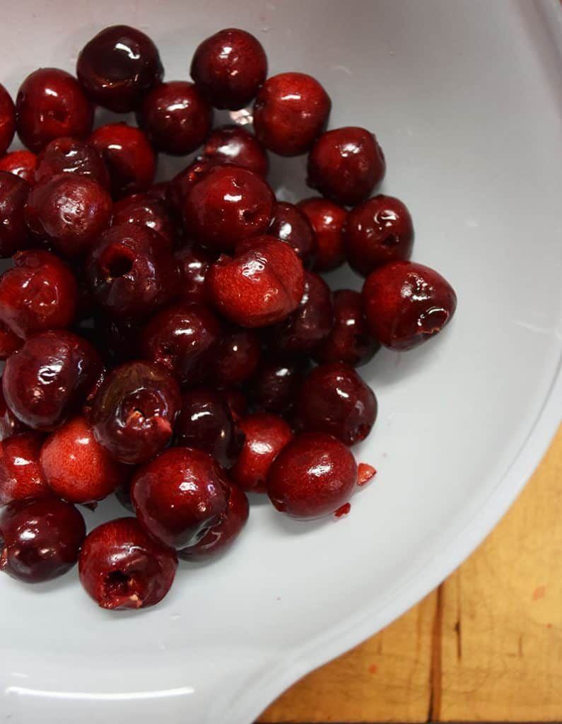 Make your own cherry-infused bourbon with this easy and simple process. A great gift idea, cocktail ingredient, and treat for bourbon lovers.