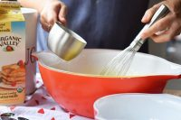 Red glass mixing bowls perfect for baking a cake.