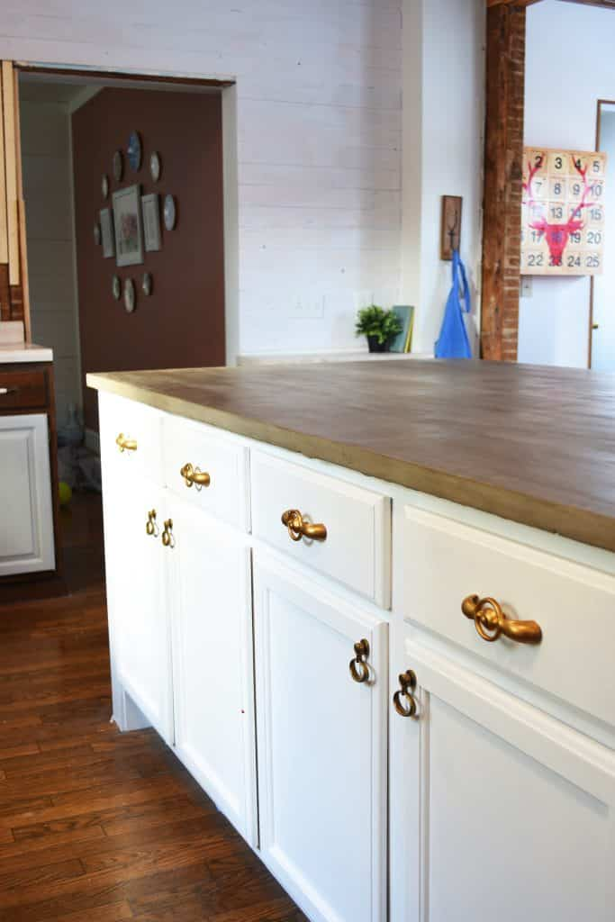 My do it yourself kitchen island with concrete countertops look closely and you can see our kitchen is still in full remodel mode look even closer and you might see my duck cookie jar on the dining room floor solutioingenieria Image collections