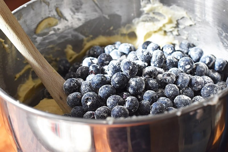 fold the blueberries gently into the blueberry sour cream bundt cake batter