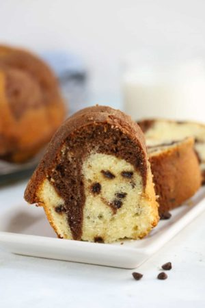 this Chocolate Chip marble bundt cake is studded with chocolate chips and utterly delicious!