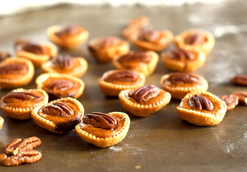 Mini pumpkin pies with a pecan on top. Pecan Pumpkin Pie bites that are easy to make!