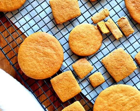 gingerbread cookies in all shapes and sizes cooling on a cooling rack