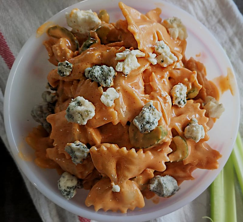 Buffalo Chicken Salad with blue cheese, in a bowl with celery sticks