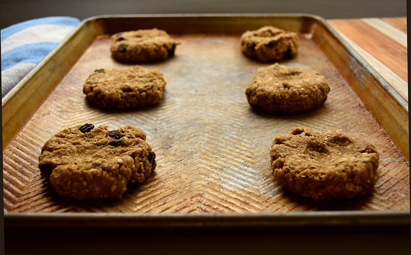the BEST Oatmeal Raisin Cookie resting on a cooling rack