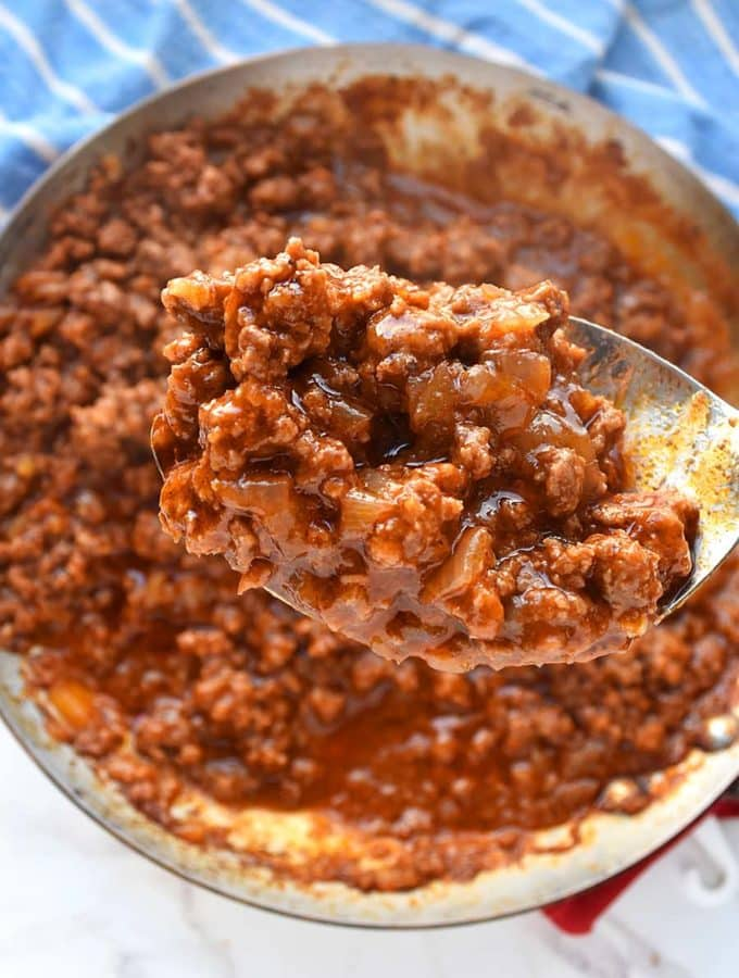 an easy and delicious sloppy joe sauce in a large spoon scooped from a skillet