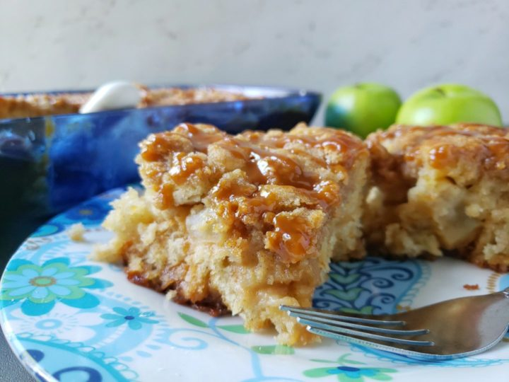 apple coffee cake on the plate with a fork