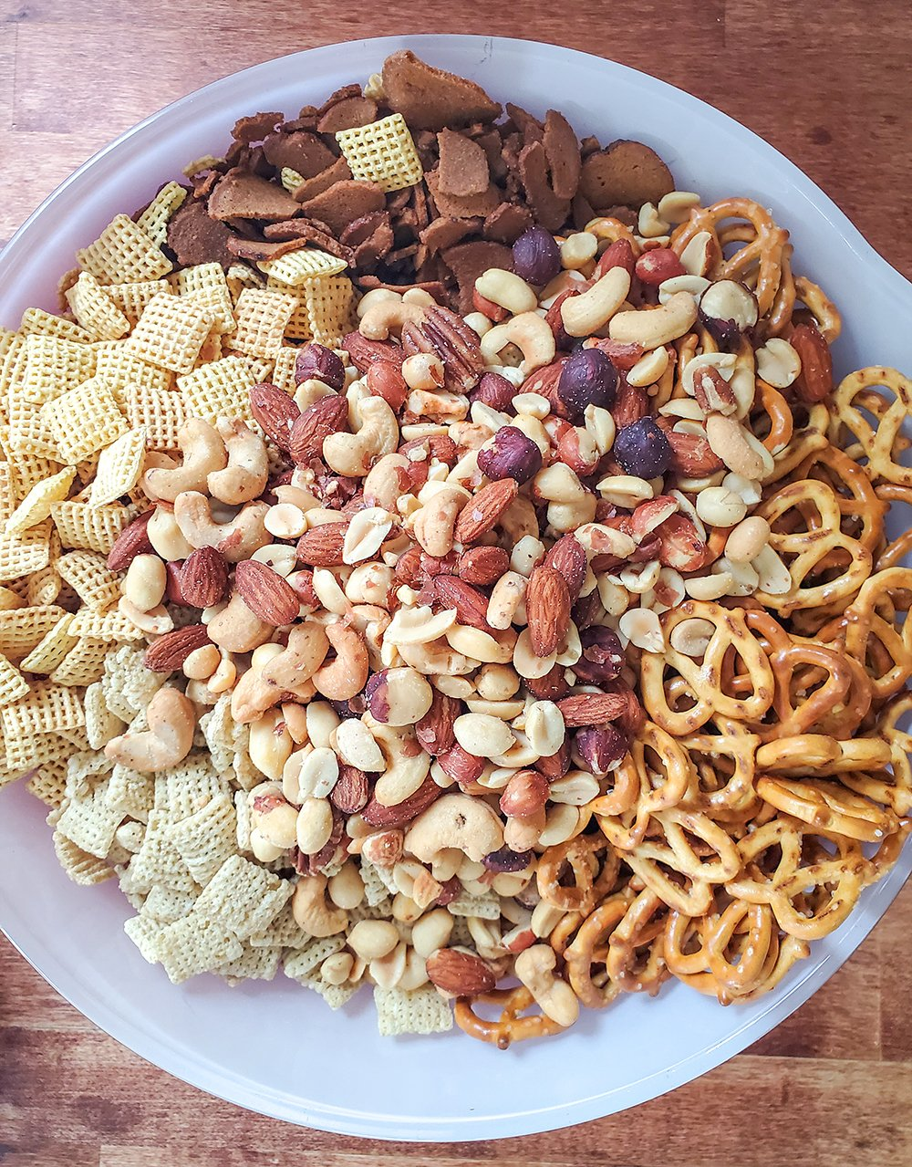 Chex mix ingredients ready to be baked.
