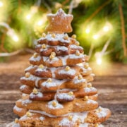 gingerbread tree is easy to make with stacked gingerbread cookies and frosting