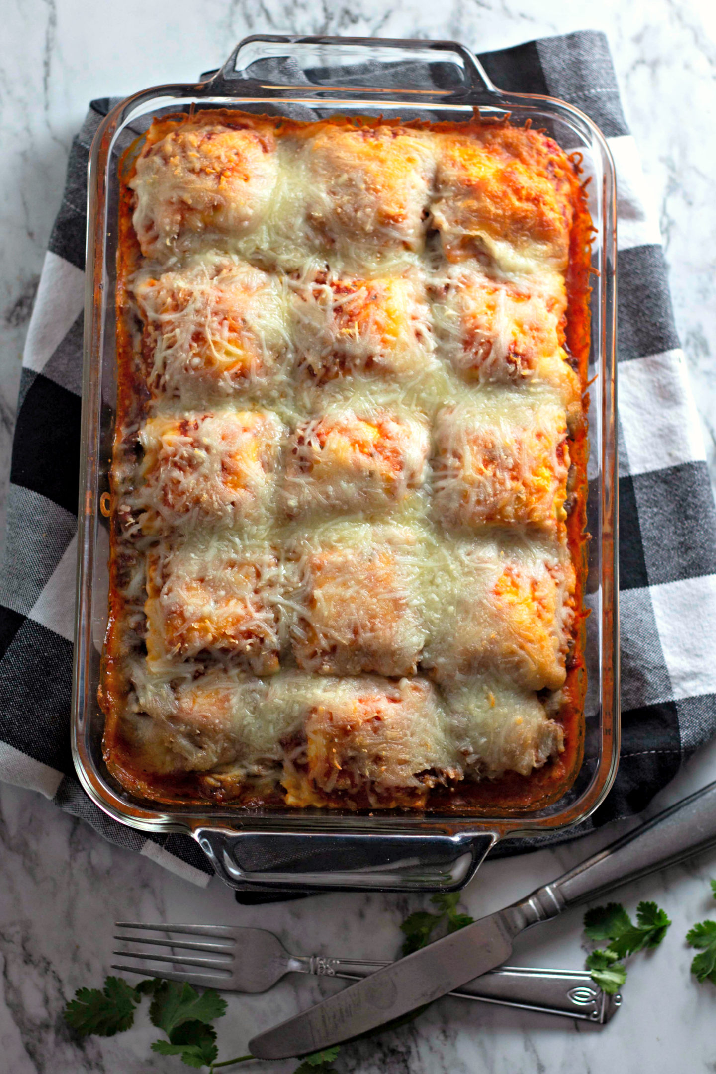 Ravioli Lasagna is a pan of baked ravioli topped with sauce and cheese.