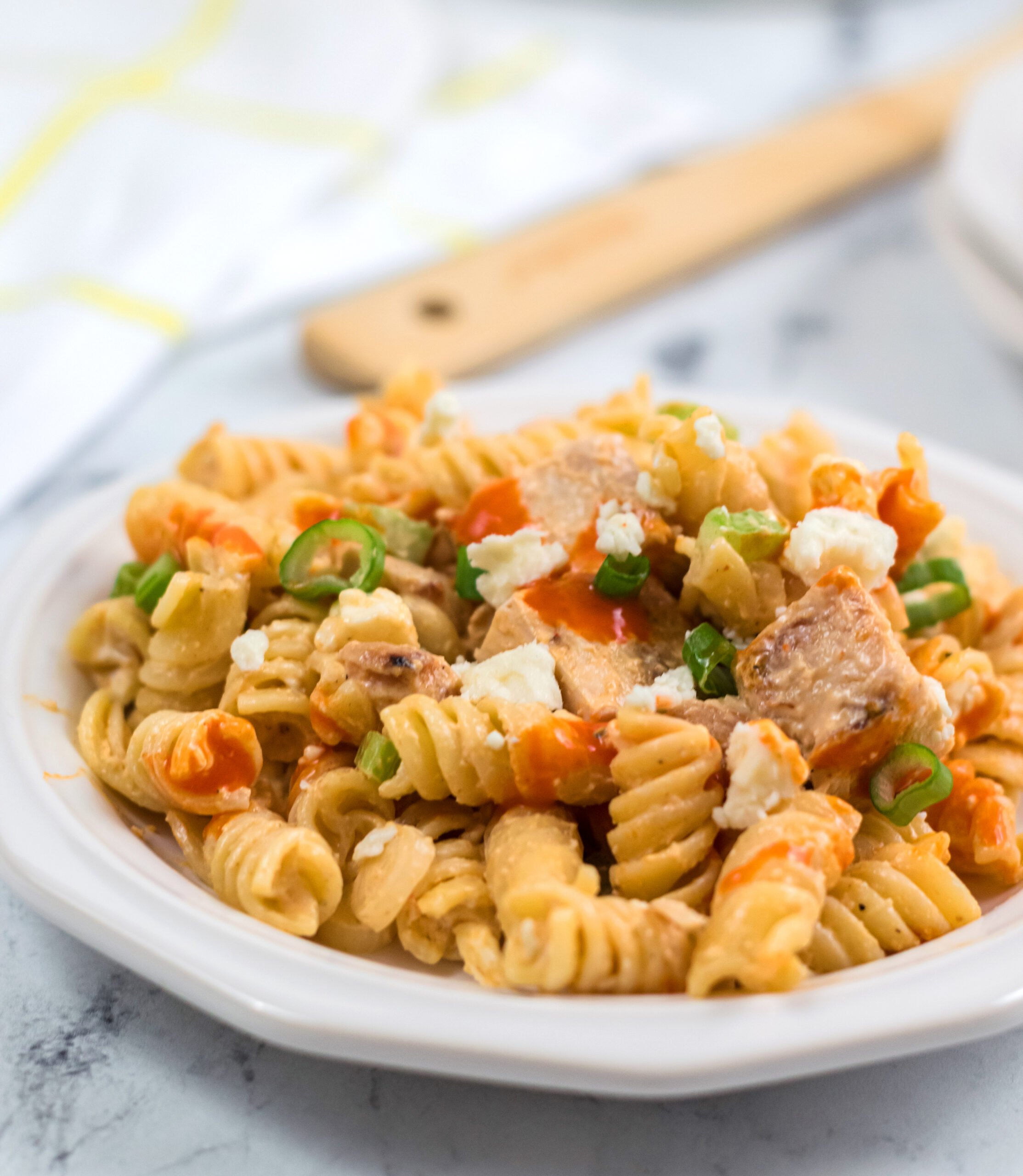 A plate full of creamy buffalo chicken pasta salad
