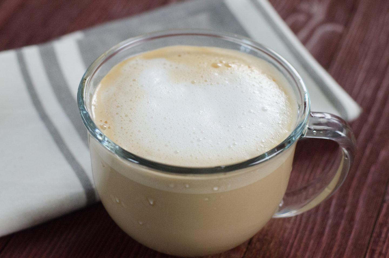 Maple cappuccino in a glass.