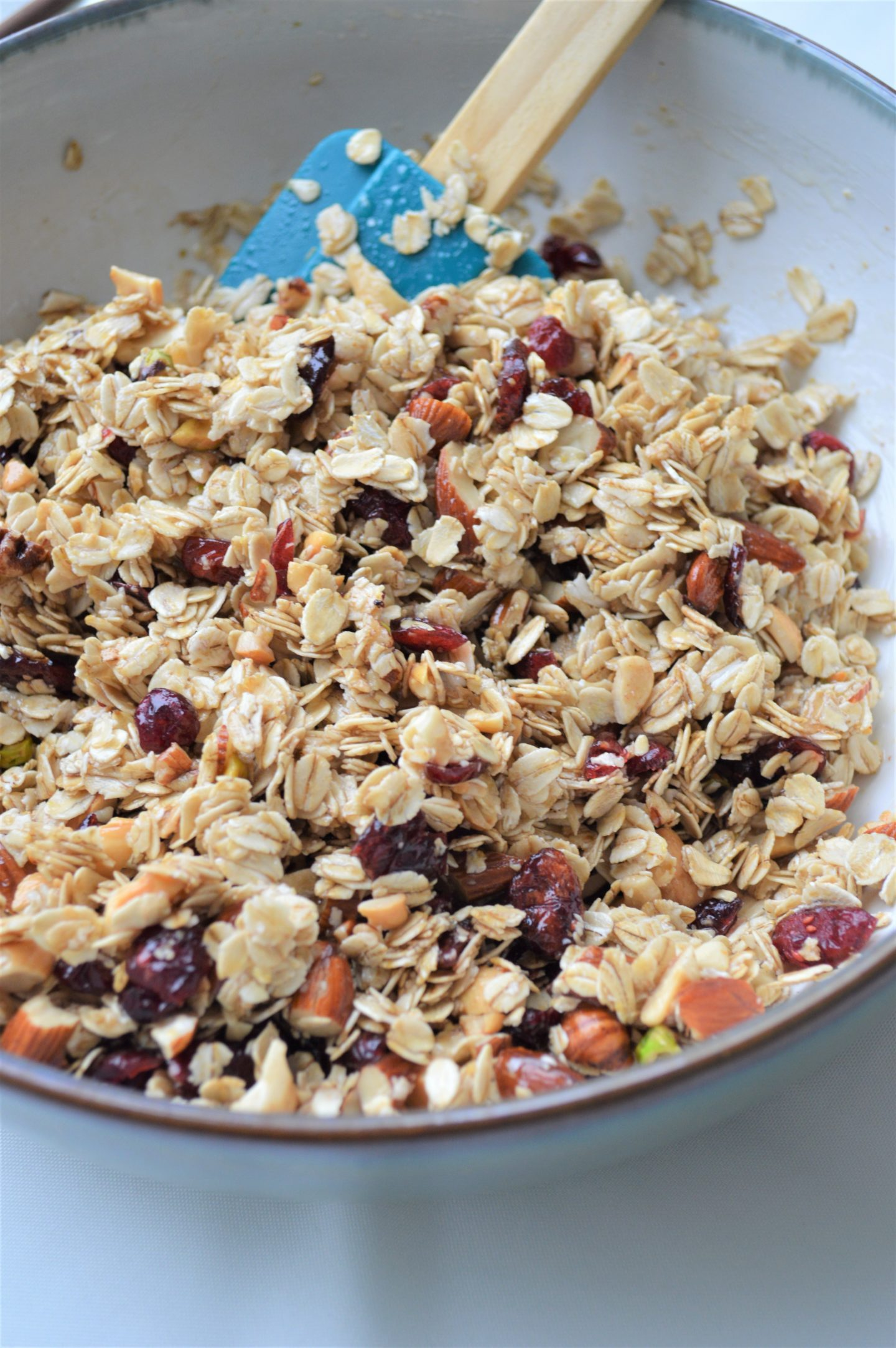 mixing up cranberries, nuts, and oats for granola.